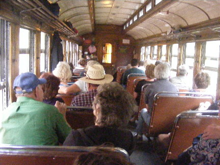 Passengers riding on the Durango & Silverton Closed Coach Car